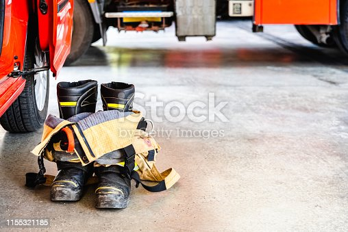 istock Flame retardant fireman's boots and pants ready to be used in case of emergency. 1155321185