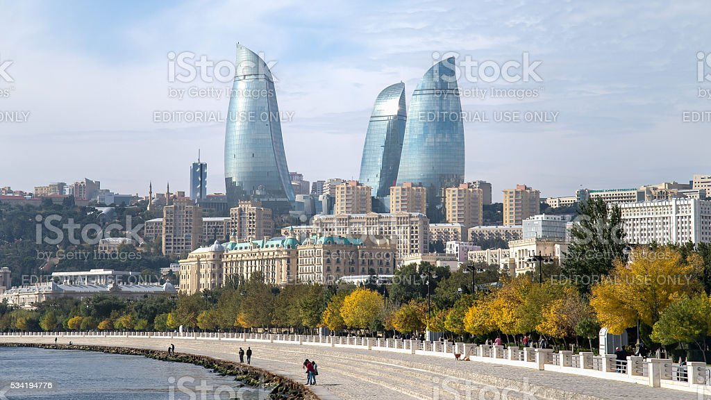 Flame towers in Baku cityscape stock photo