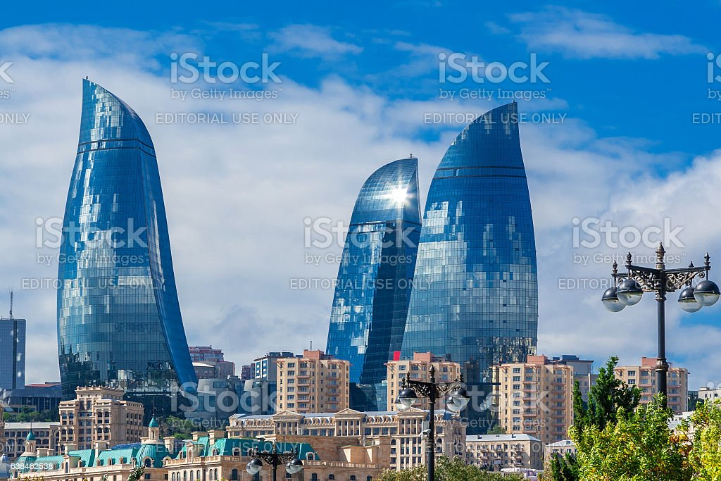 Flame towers in Baku cityscape. stock photo