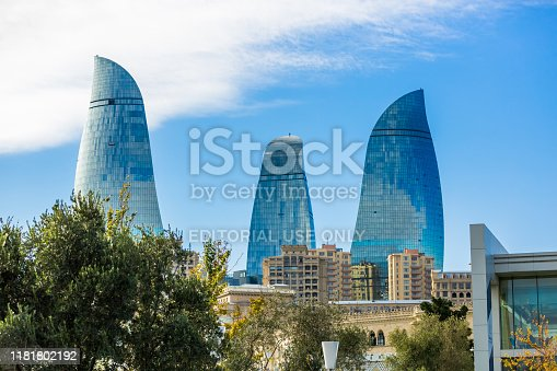 Baku, Azerbaijan, Novemver 07.2016: Flame Towers, the symbol of the capital of Azerbaijan, with facades covered with the LED screens showing the fire movement. Close-up view of fire skyscrapers