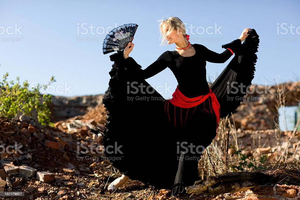 A flamenco dancer dancing outside stock photo