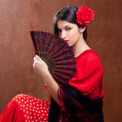 istock Flamenco dancer woman gipsy red rose  spanish fan 177013192