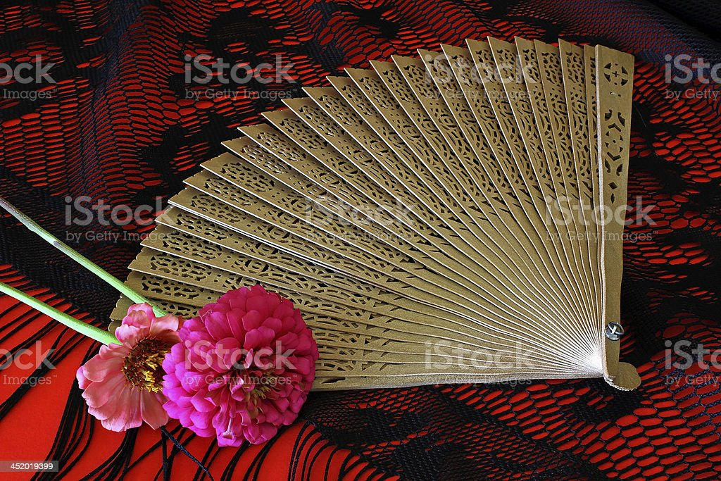 Still life of Spanish Flamenco Dancer\'s Fan on black lace shawl with...