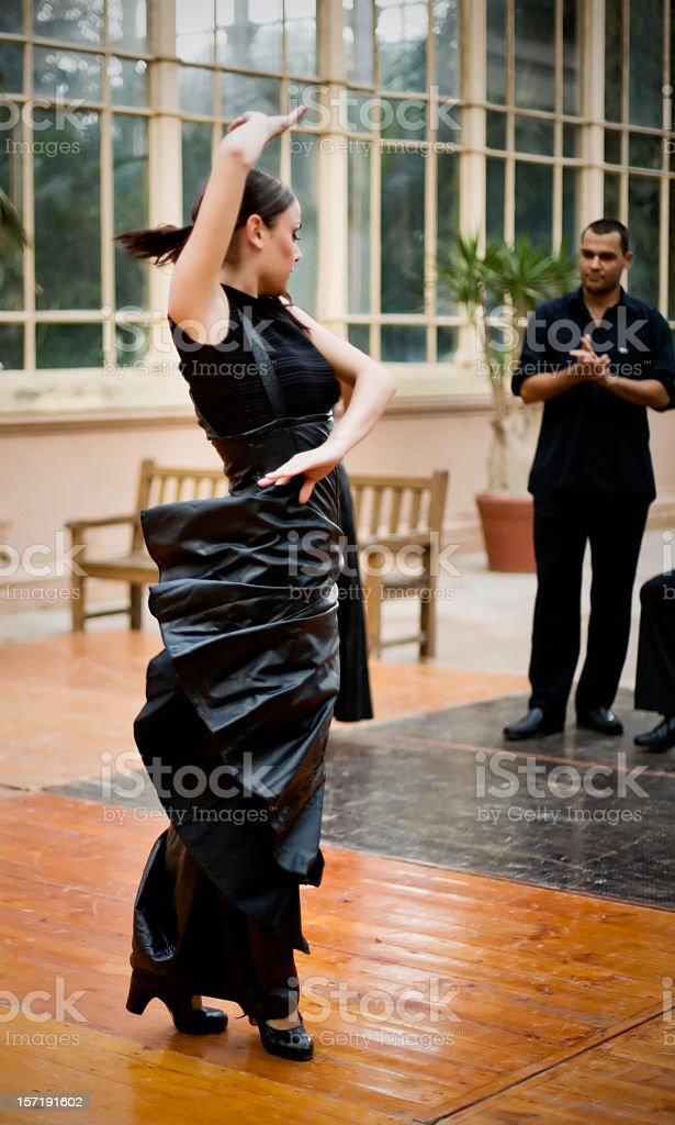 Flamenco female dancer performing with a group of singers. royalty-free stock photo