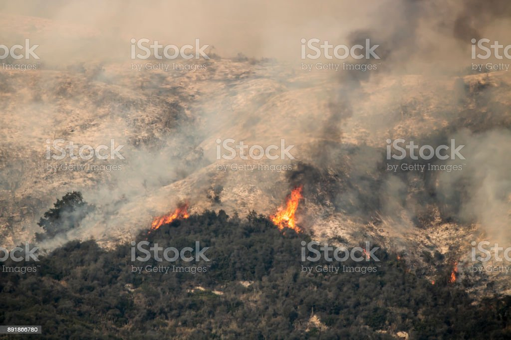 Flames Burn on Hills During California Wildfires Thomas Fire stock photo