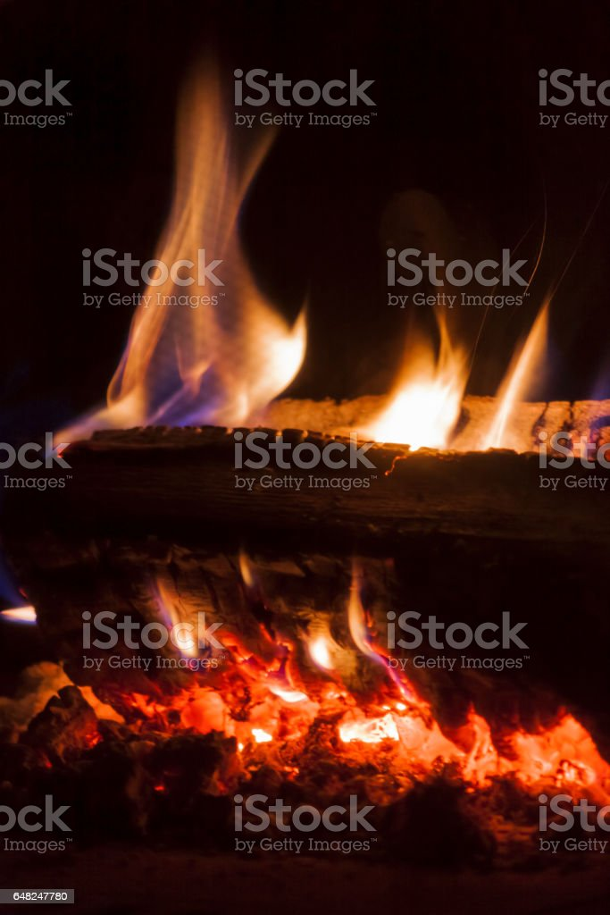 Flames from carbonized wood stock photo