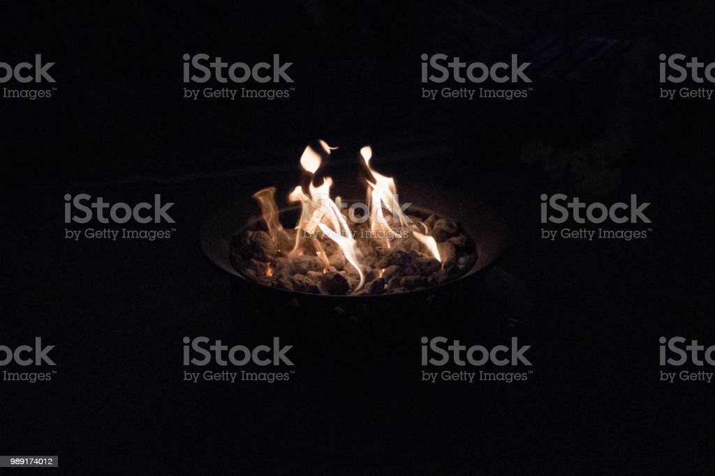 flames in a coal fire providing heat on a cold night stock photo