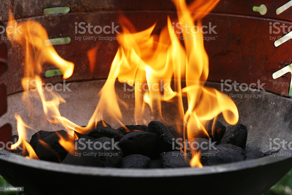 Flames in barbecue royalty-free stock photo