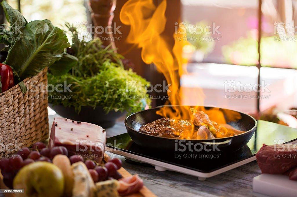 Flames in frying pan. stock photo
