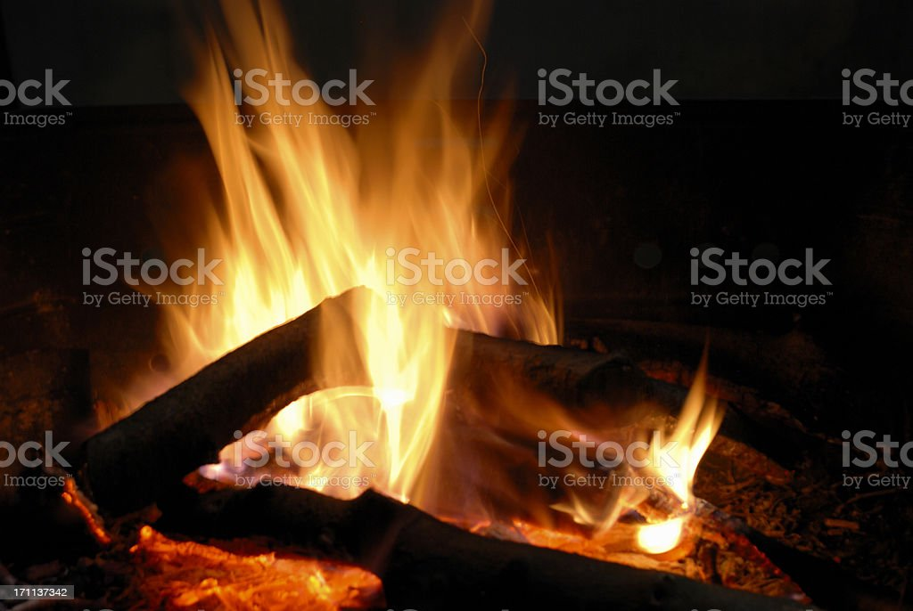Flames of a log fire at night royalty-free stock photo