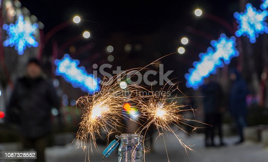 977840698 istock photo Flames of Bengal fire on the streets of the night city in defocus 1087328552