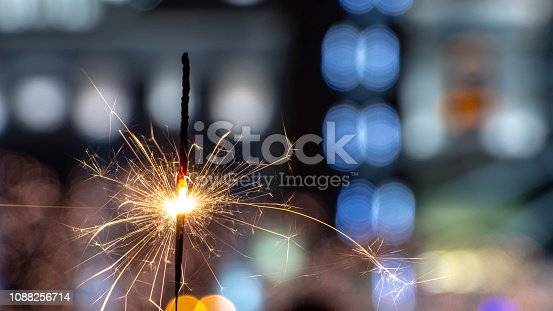 istock Flames of Bengal fire on the streets of the night city in defocus 1088256714