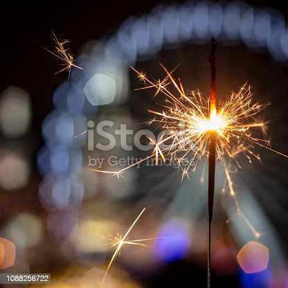 977840698 istock photo Flames of Bengal fire on the streets of the night city in defocus 1088256722