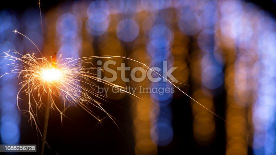 istock Flames of Bengal fire on the streets of the night city in defocus 1088256728