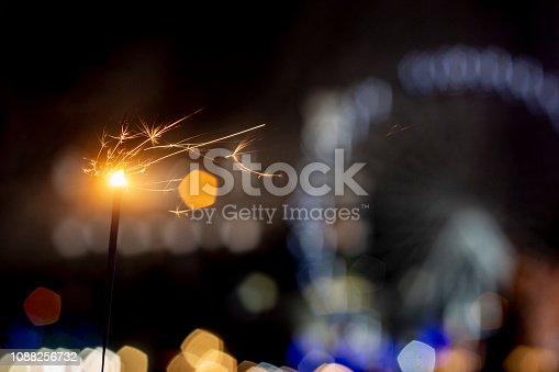 istock Flames of Bengal fire on the streets of the night city in defocus 1088256732
