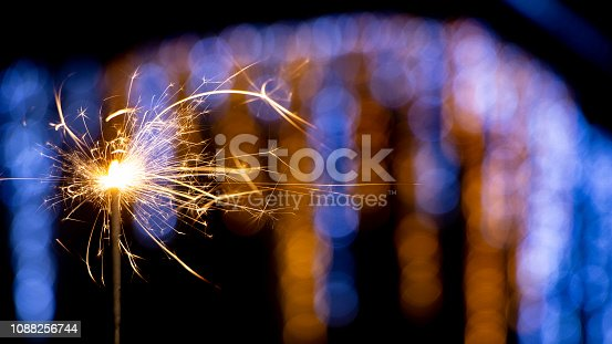 977840698 istock photo Flames of Bengal fire on the streets of the night city in defocus 1088256744