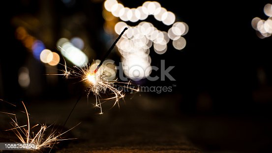 977840698 istock photo Flames of Bengal fire on the streets of the night city in defocus 1088256750