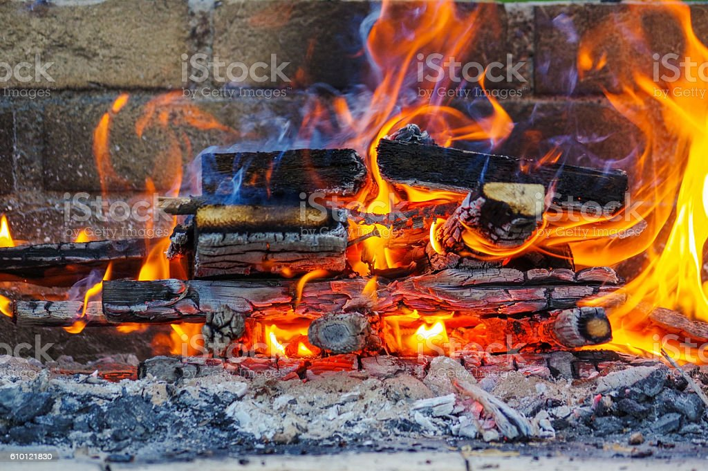 Flames on a Barbecue grill with lot of charcoal stock photo