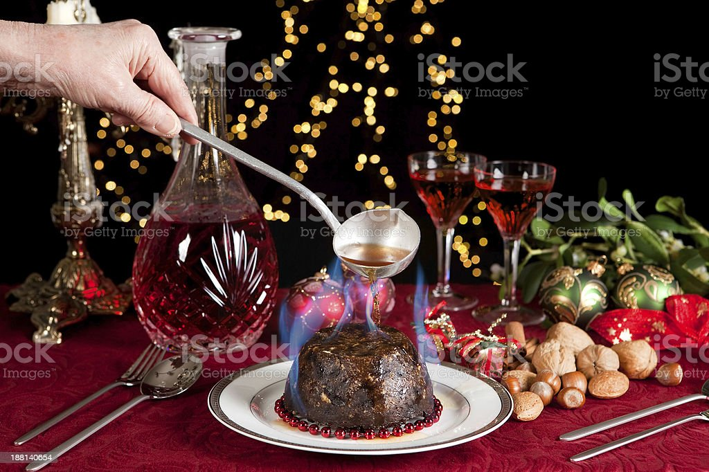 Flames on the christmas pudding stock photo