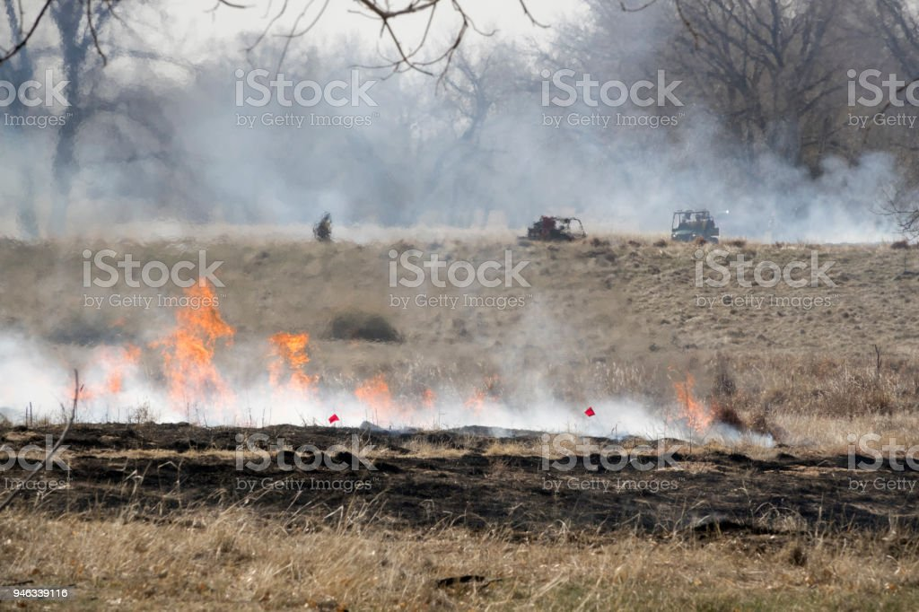 Flames rise controlled fire burn Rocky Mountain Arsenal National Wildlife Refuge Colorado stock photo