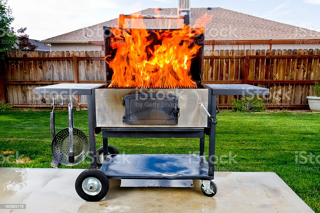 Flaming Barbecue Grill royalty-free stock photo