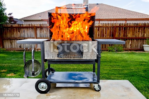 istock Flaming Barbecue Grill 182863779