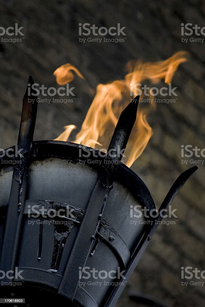 Flaming basket used for lighting royalty-free stock photo