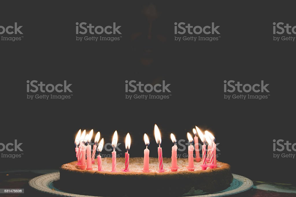 Flaming Birthday Candles stock photo