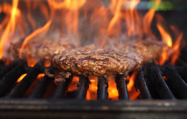 Flaming Burgers stock photo