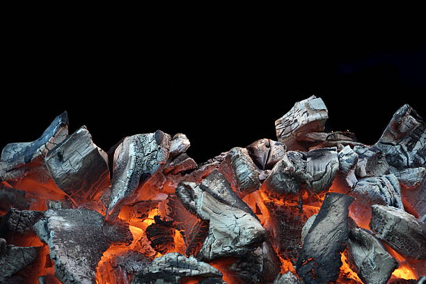Flaming Charcoal Isolated On Black Background stock photo