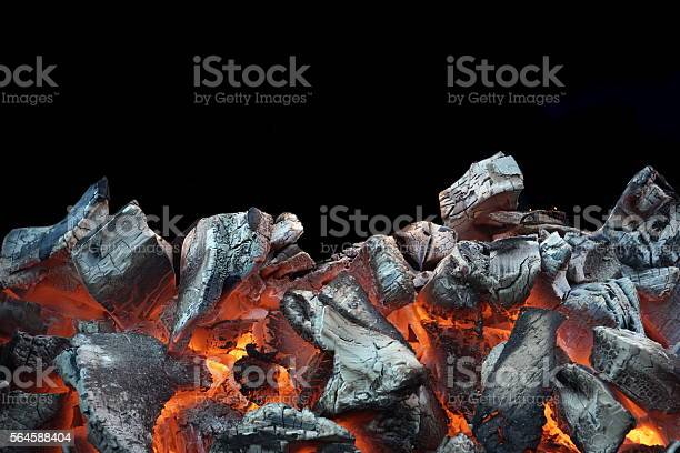 Photo of Flaming Charcoal Isolated On Black Background