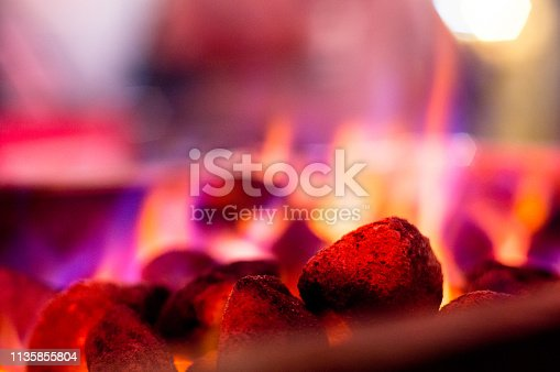 Flaming coals hot rocks with multicolored flames for barbeque, tikka, kebabs. These allow for these delicacies to be created indoors, or in camp sites