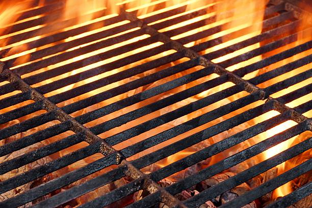 BBQ Flaming Grill And Glowing Coals Close-up stock photo