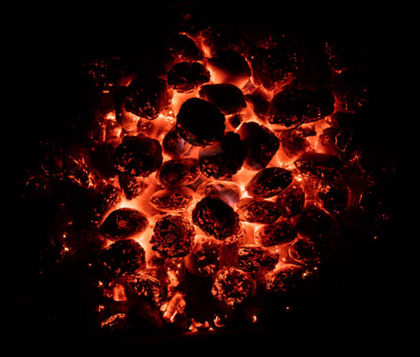 flaming hot charcoal briquettes in detail - coal stock pictures, royalty-free photos & images