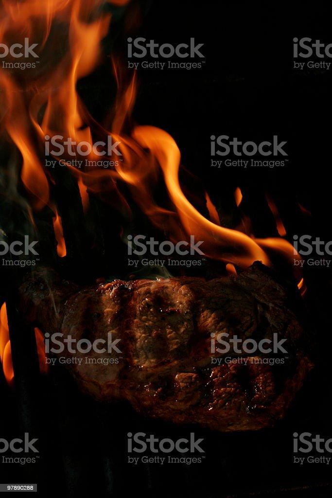 Flaming Rib Eye Steak royalty-free stock photo