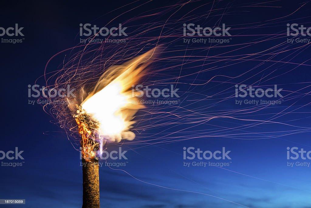 Flaming Torch at Night stock photo