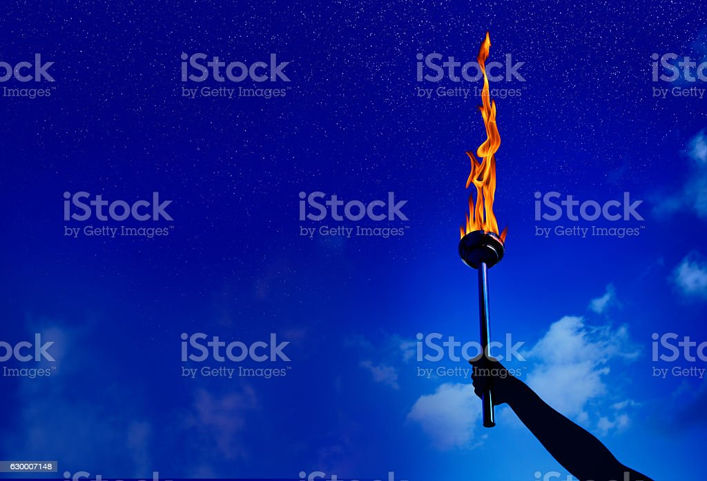 flaming torch of success stock photo