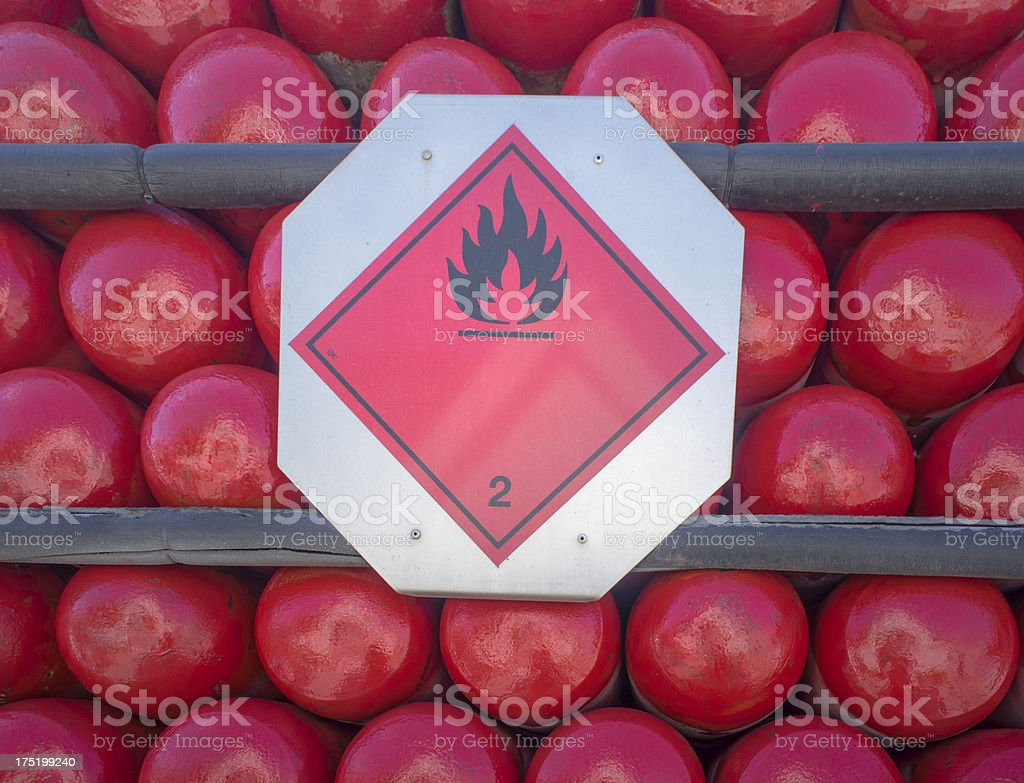 Flammable sign on a truck transporting propane gas cylinders stock photo