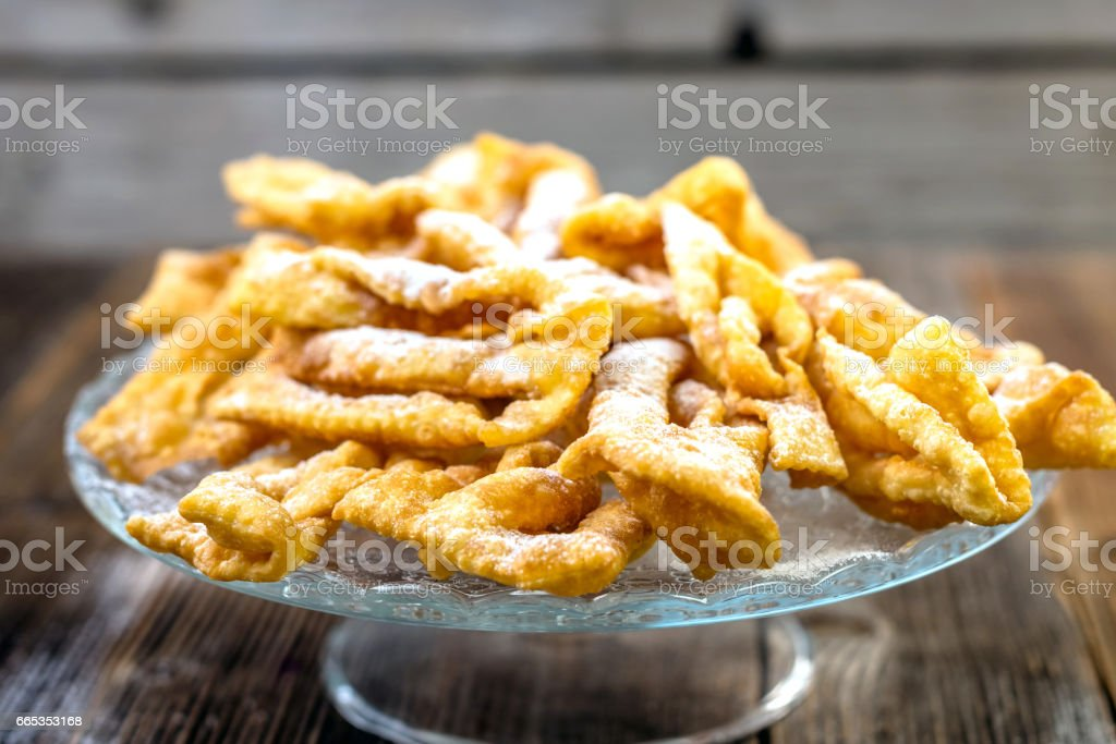 Flancat- crisp deep fried pastry dusted with powdered sugar stock photo