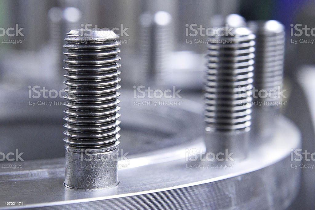 Flange with bolts prepared for  focused on first bolt stock photo