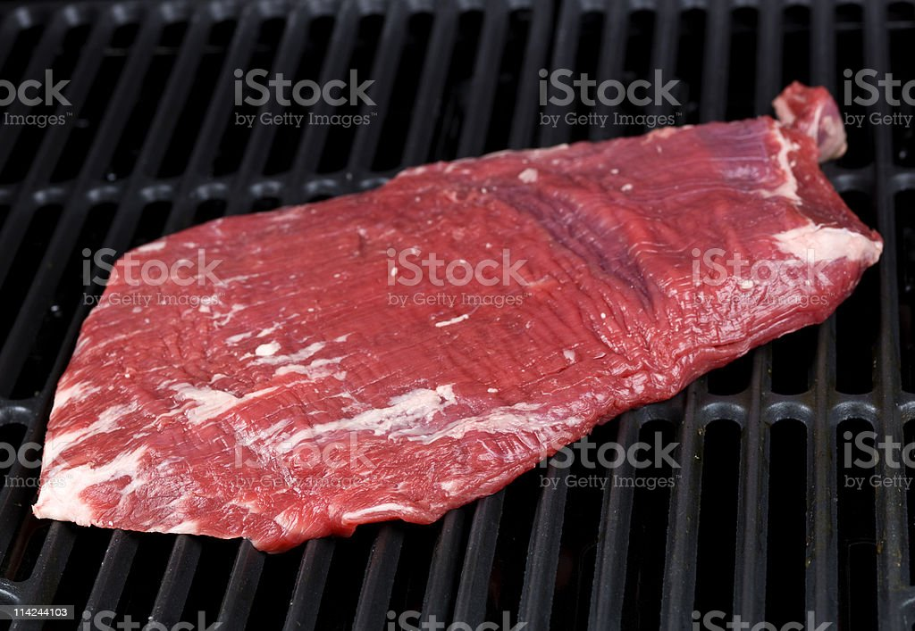 Flank steak ready to be grilled royalty-free stock photo