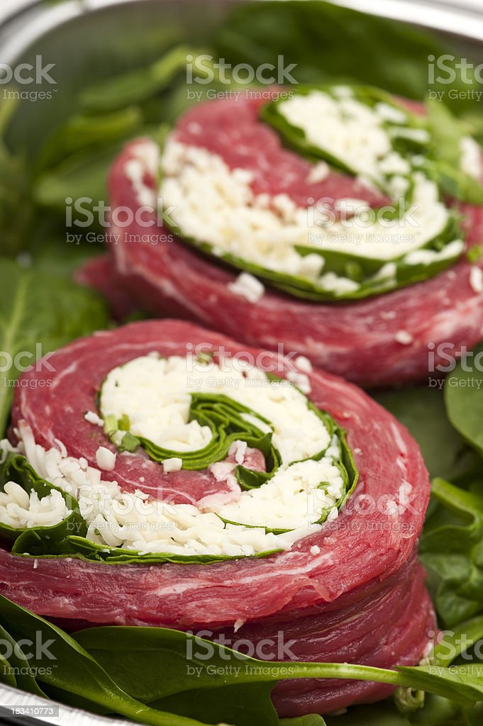 Flank steak rolled with mozzarella cheese and spinach stock photo