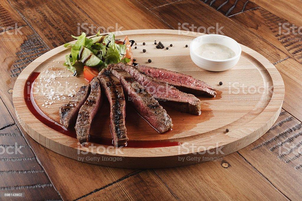 Flank steak with salad stock photo