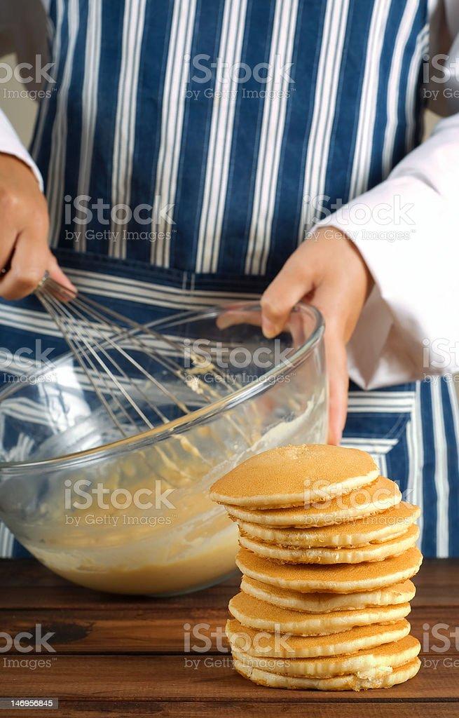 Flapjacks or pancakes and whisking mixture royalty-free stock photo