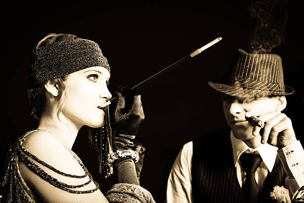 flapper girl and gangster - 1920s style stock photos and pictures