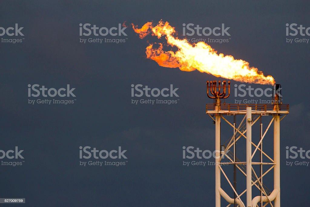 Flare burn on oil rig stock photo