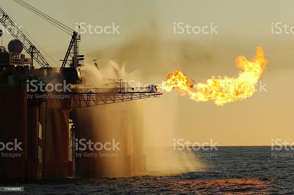 Flare on an ocean oil rig. stock photo