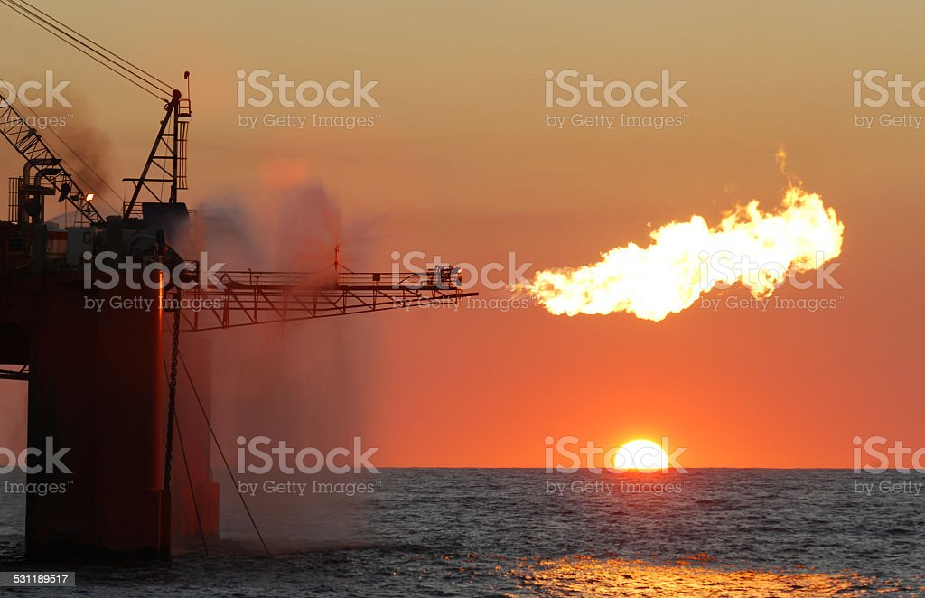 Flare on an ocean oil rig. stock photo