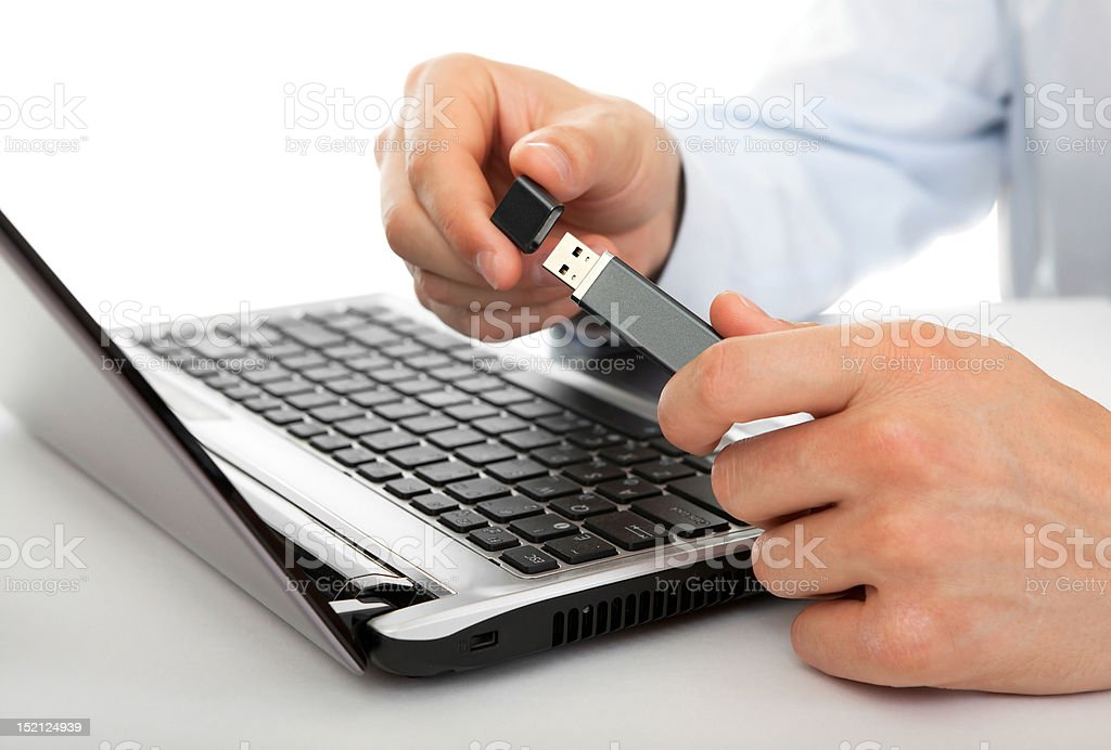 USB flash drive in men's hands royalty-free stock photo