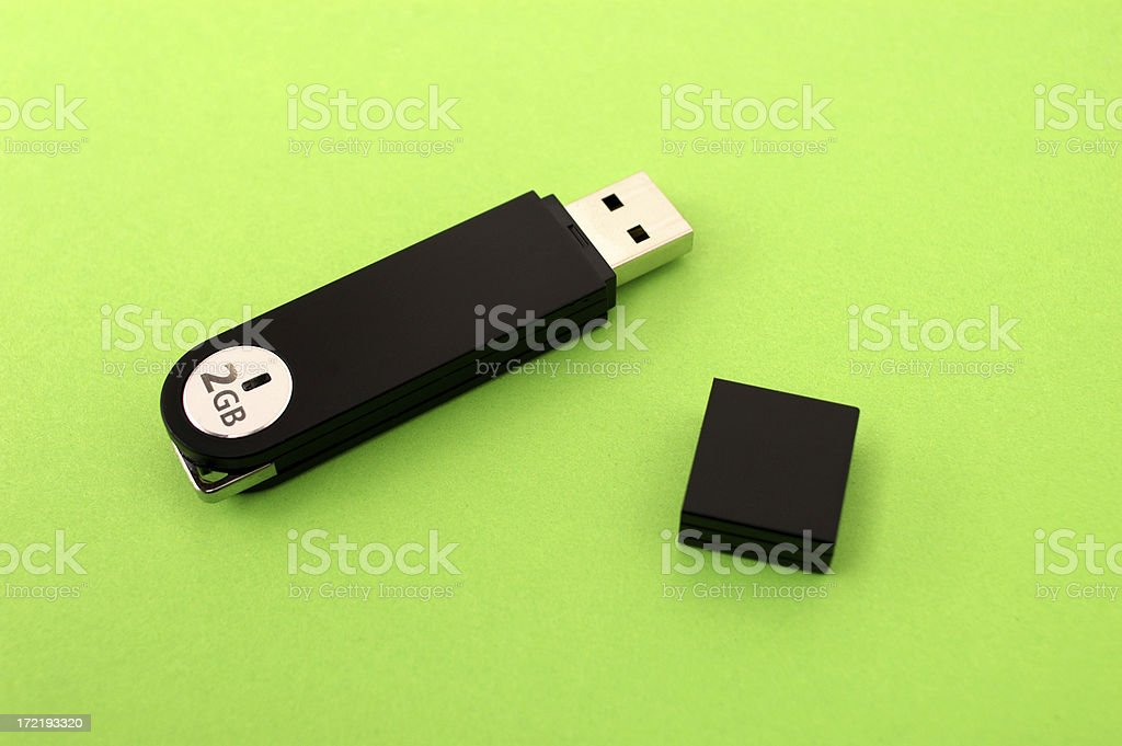 2GB flash drive on green background.